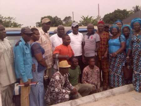 Sir Kenny Okolugbo (centre with face cap and white polo) in group pictures with the physically challenged.
