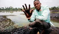 Eric Dooh at home in Goi village showing oil pollution