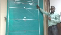 Dr Bonnyface Opia explaining to audience how the Beautiful Ball Game is played after unveiling the game in Lgos recently...........