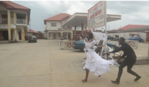 The bride storming out of the reception venue with the bridegroom running after her