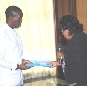 Chief Nkem Okwuofu, Chairman Verification Committee presenting their findings  to Dr Ifeanyi Okowa