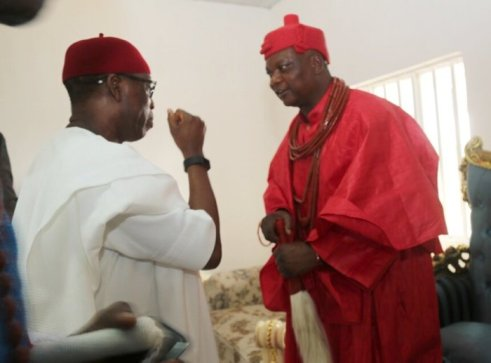 Delta State Governor, Dr Ifeanyi Okowa paying respect to the  the Ovie of Agbon, Ogurimerimr Ukori 1 the traditional way