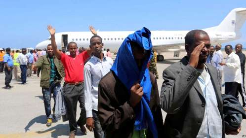 FILE- Deported Somali nationals gesture as they arrive at the airport in Somalia's capital of Mogadishu, April 9, 2014. Sixty-eight Somalis arrived in Mogadishu Friday, having been deported by U.S. immigration authorities.