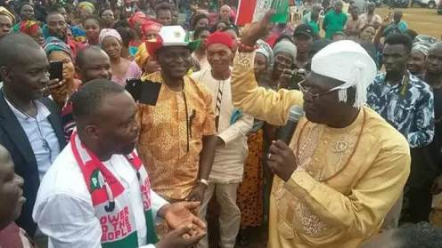 Delta state PDP chairman, Kingsley Esiso, receiving Baxim Chinye in Aniocha area of the state