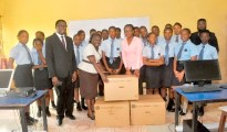 3. Students of Chief Executive Officer  of Gamaliel and Susan Onosode Foundation, Toyin Olanrewaju (R), presenting cartons of computer system to the Principal of Westminster College Lagos, Mrs. Helen Ayisire (L),  while Director, Westminster College Lagos, Chief Johnson Barovbe (On dark suit left) , Assistant Director Westminster College Lagos, Mr. Onoriode Johnson (behind far right) and students of Westminster College  L