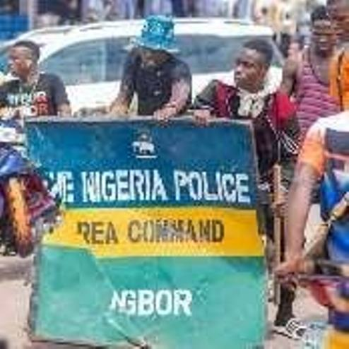 EndSARS Protesters Raid Agbor Police Station, Cart Away Sign Post