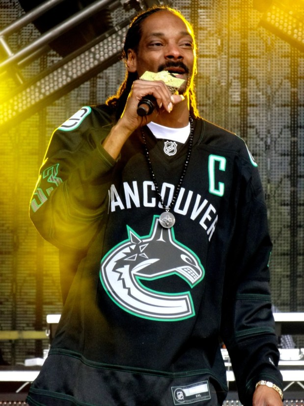 Snoop rocks a Vancouver Canucks jersey on-stage in BC. Not sure if he provided the smoke himself.