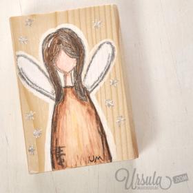Christmas fairy on wooden block