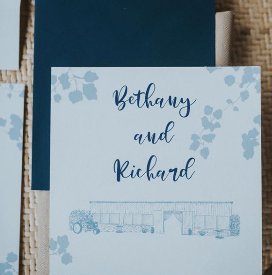 Square wedding invitation with leaf silhouettes in dusty blue