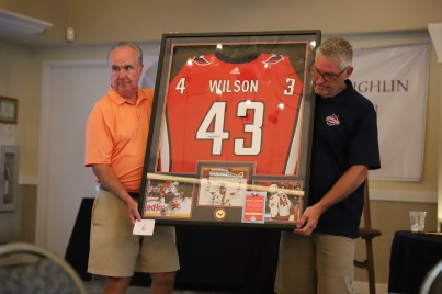 Al and Craig serve as the models for the Wilson jersey.