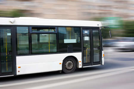 white city bus goes along street Stock Photo - 15197498