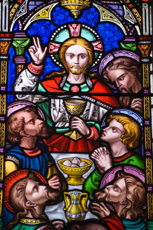 holy grail: A Victorian stained glass window depicting the Last Supper, or Holy Eucharist. Jesus Christ holding the Holy Grail with his disciples dining on bread and wine. Editorial