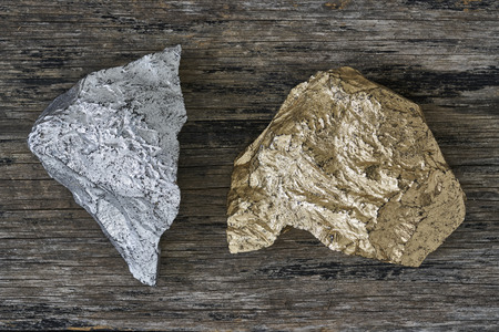 silver ore: Gold and Silver ore on wood plate