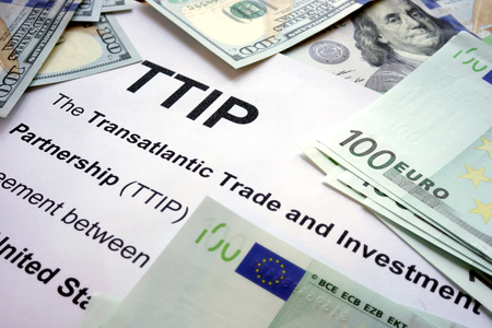 ttip: Word TTIP on a paper with dollars and euros. Stock Photo