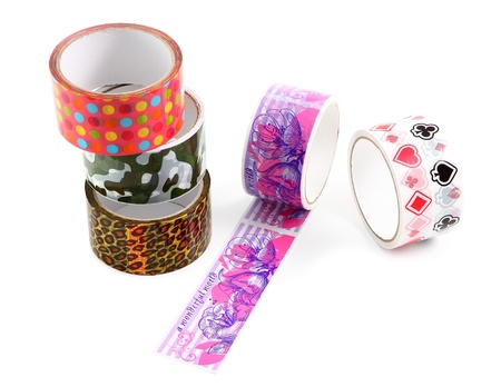 Set of several rolls of colored packing tape with colorful decorative print. Polka dot print, camouflage print, animal print, leopard print. Stock Photo - 20231087
