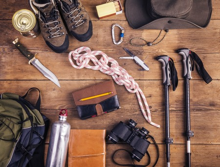 survival equipment: Equipment for hiking on a wooden floor background Stock Photo