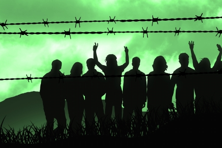 war refugees: people are captured behind barbed wire Stock Photo