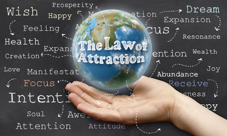 Holding the World with The Law of Attraction Stock Photo - 27883132