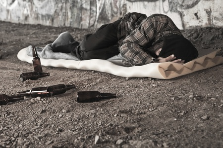 Homeless alcoholic sleeping outdoors  Stock Photo - 10582221