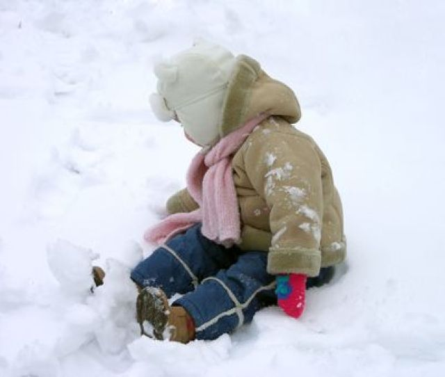 Little Girl Playing Herself At The Snow Stock Photo 2375331