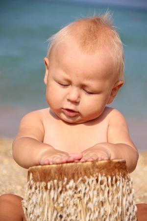 funny kid Drumming on the beach Stock Photo - 34676364