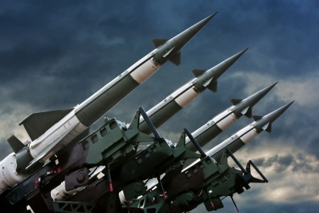 missile: Antiaircraft  rockets on the launcher against dramatic sky.
