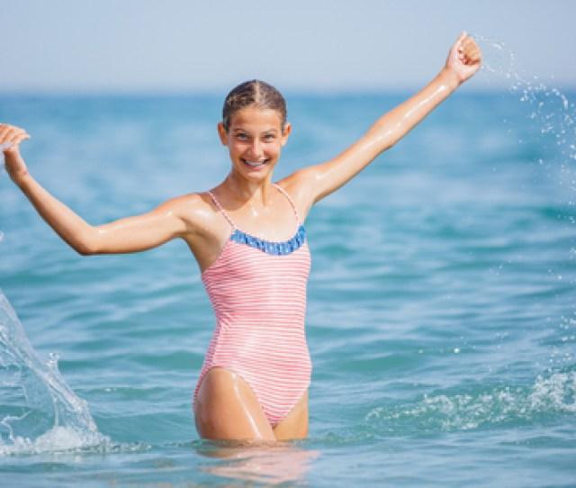 Girl In Swimsuit Having Fun On Tropical Beach Stock Photo