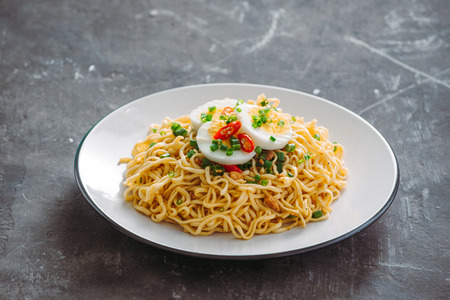 Dry instant noodle - asian ramen and vegetables for the soup Stock Photo - 120514193