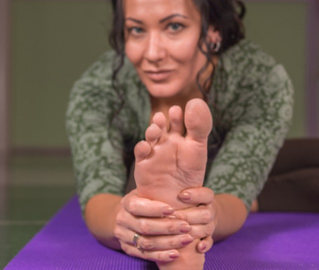 Professional Yoga Trainer Showing Yoga Asana In The Gym Stock Photo
