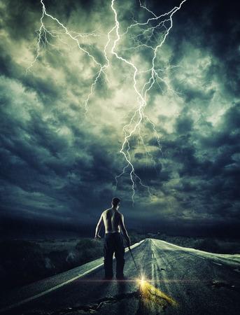 STORMY NINJA: Warrior opening the road with his Katana sword Stock Photo