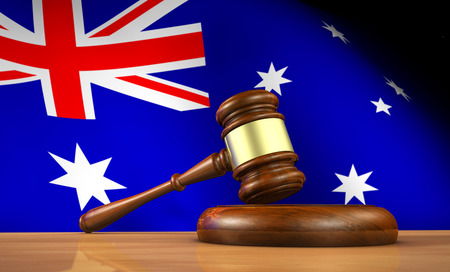 australian law icon symbol: Australian law and justice concept with a 3d rendering of a gavel on a wooden desktop and the flag of Australia on background.