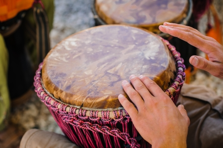 Man playing the djembe (african drum) outdoors Stock Photo - 15488434