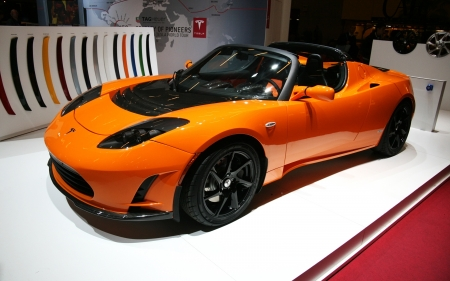 PARIS - OCTOBER 14: The Tesla Roadster electric automobile at the Paris Motor Show 2010 at Porte de Versailles, on October 14, 2010 in Paris, France Stock Photo - 7996624