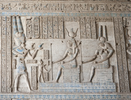 hieroglyphics: Hieroglyphic carvings and paintings on the interior walls of an ancient egyptian temple Stock Photo