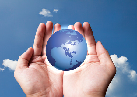 human hand holding earth on blue sky Stock Photo - 41598212