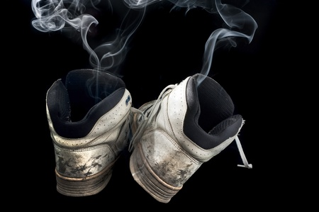 pair of rotten old sneakers on a black background Stock Photo - 9146826