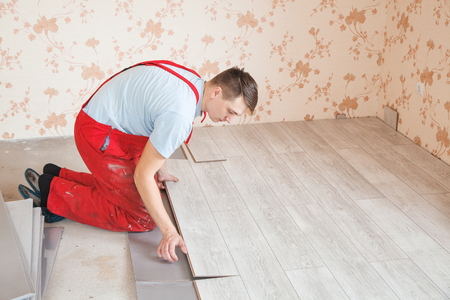 Handyman Fixing Laminate Flooring Boards While Renovating A House     Handyman fixing laminate flooring boards while renovating a house Stock  Photo   89463113