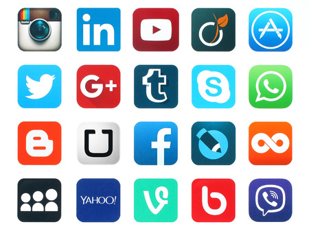world news symbols icons: Kiev, Ukraine - January 23, 2016: Popular social media icons such as: Facebook, Twitter, Blogger, Linkedin, Tumblr, Myspace and others, printed on white paper.