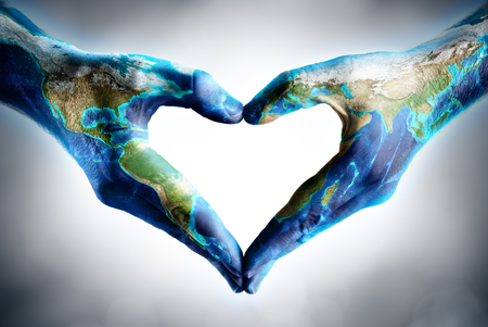 the world: earths day celebration - hands shaped heart with world map