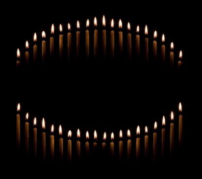 Group of tapered candles form a candle light circle or curve money spells