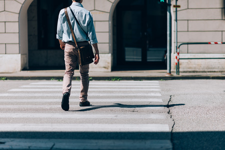 Image result for man walking quickly back view street