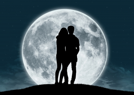silhouette of a young couple in love looking at the full moon Stock Photo - 25244889