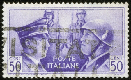 BENITO MUSSOLINI: ITALY - CIRCA 1941 A stamp printed by the fascist Italy Post is a portrait of Adolf Hitler and Benito Mussolini, circa 1941