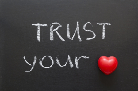 truth: trust your heart phrase handwritten on blackboard