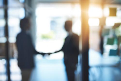 iStock handshake deal 682631654%20(500%20x%20334) - Chubb, DBS announce 15-year regional deal