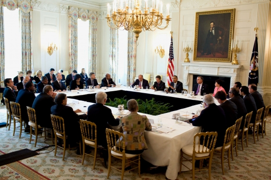The official ##http://www.whitehouse.gov/blog/2010/10/11/president-infrastructure-investment-work-needs-be-done-there-are-workers-who-are-rea##White House## photo of the president's meeting on infrastructure. That's Angela Glover Blackwell in the center, in the gold-checkered jacket.