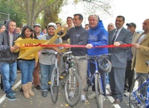 The next bike-facility ribbon-cutting could be in your community, if you know how to sell funders on the benefits. Photo: ##http://lacityorgcd13.blogspot.com/2010_12_01_archive.html##Eric Garcetti##
