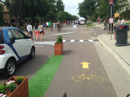 The Minneapolis Bicycle Coalition installed this pop-up lane and intersection treatment at an Open Streets event to show neighbors what a protected bike lane could look like.