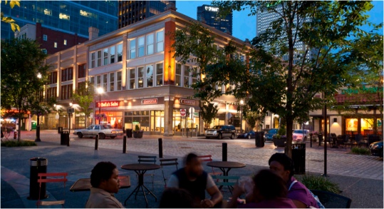 "Pittsburgh's Market Square keeps the cobblestone street on the same plane as the sidewalk cafés on the perimeter and the plaza in the middle, indicating to drivers, ""you're not on a highway anymore."" Photo: Strada, LLC"