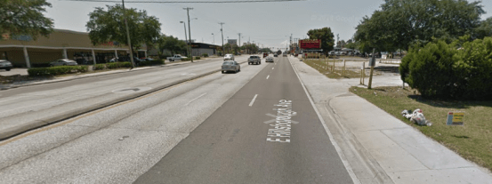 You can see, on the right hand side of this image, a memorial to one of two teenage girls killed while trying to cross Hillsborough Avenue in Tampa. Image: Google Maps